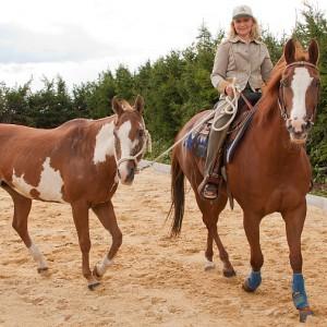 Christine Mey auf einem Pferd